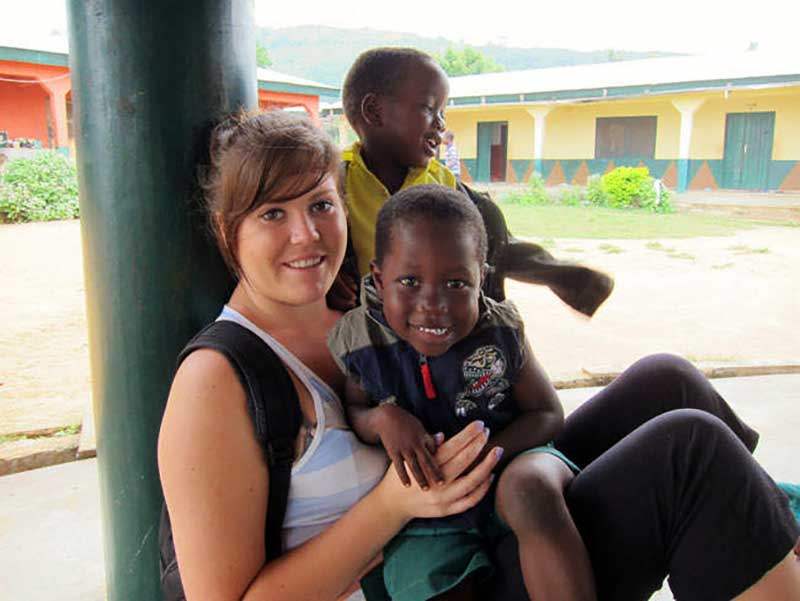 Volunteer with children at an orphanage in Ghana